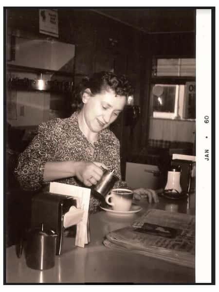 Kitty pouring coffee in La Bella