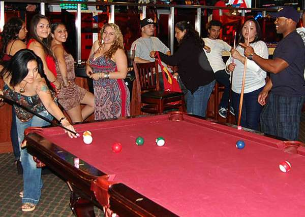 people playing biliards at the pool table