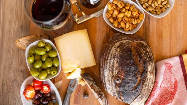 bread and olives with wine