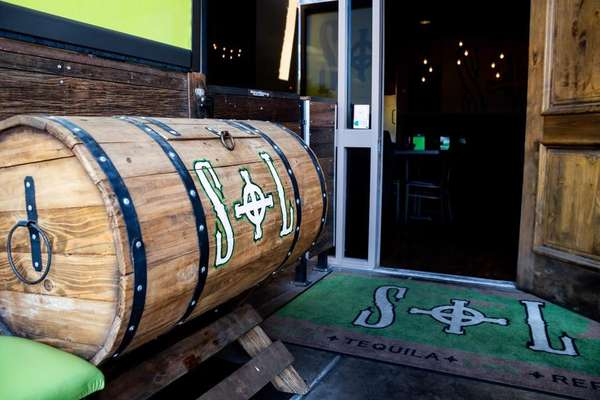 Wood barrel with S + L painted on it