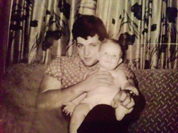 Dad holding a baby
