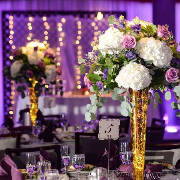 decorated table with flower centerpiece