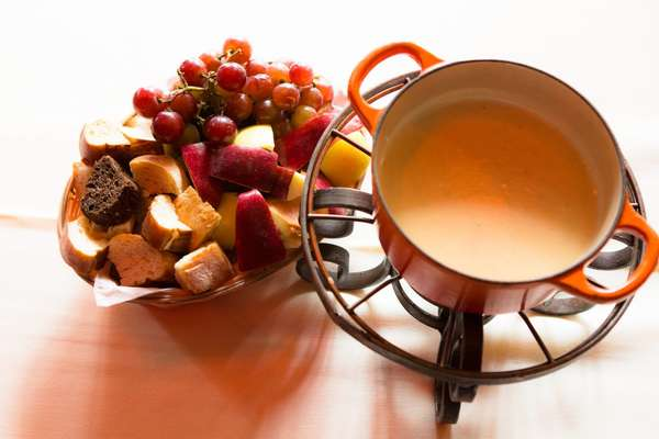 cheese fondue with bread and fruit