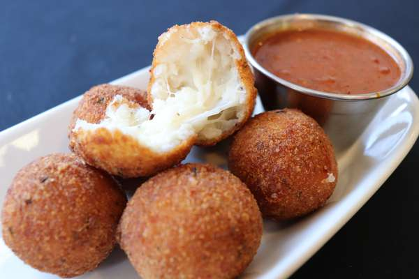 Arancini with Pomodoro Sauce and Shaved Parmesan