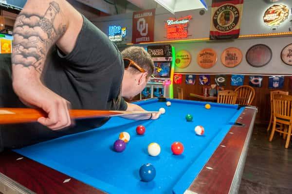 guy playing pool
