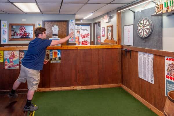 guy throwing darts
