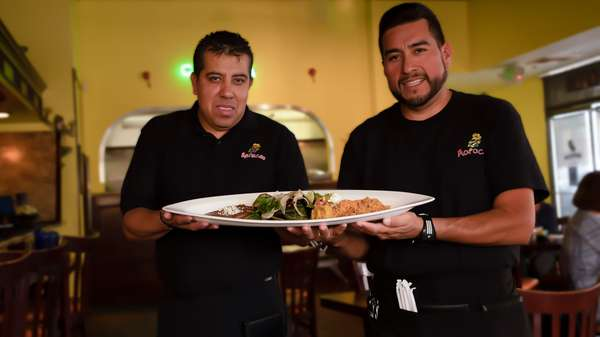 carnitas plate with chefs