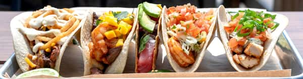 Five different styles of tacos