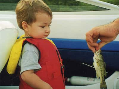 child with fish