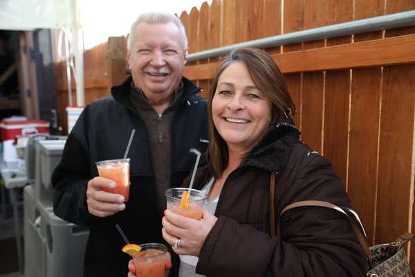 smiling people with drinks