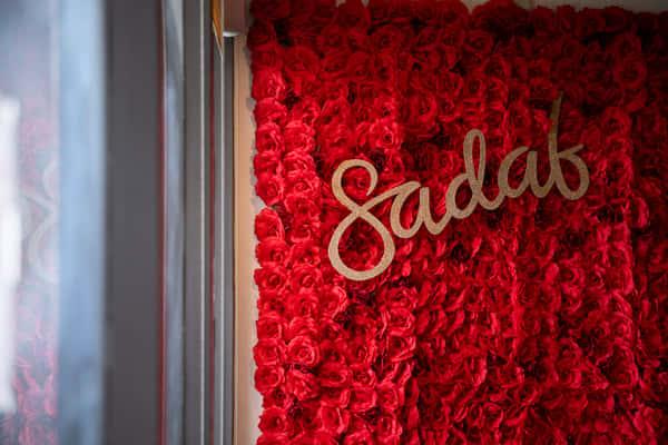 wall with flowers and sadaf logo