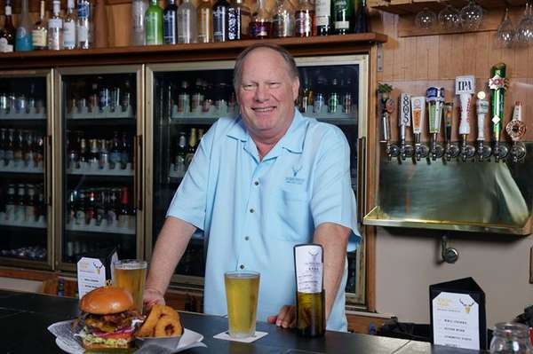 owner behind the bar