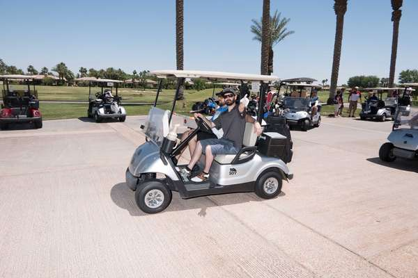 people in golf cart