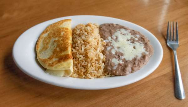 Cheese quesadilla, rice and refried beans.