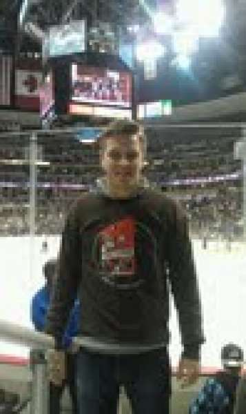 Dustin in a Red Pepper shirt in the Pepsi Center for an Avs game.