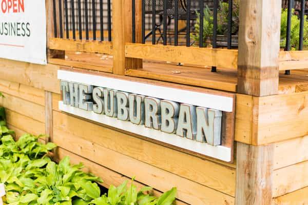 The Suburban sign