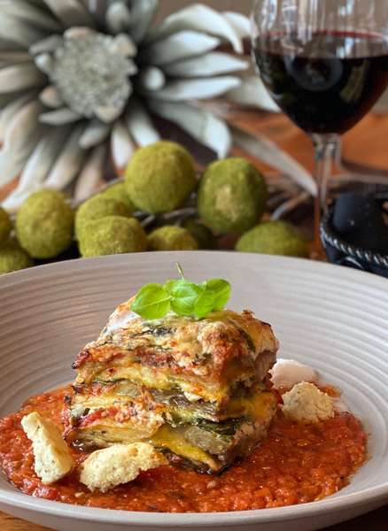 Lasagna with glass of wine