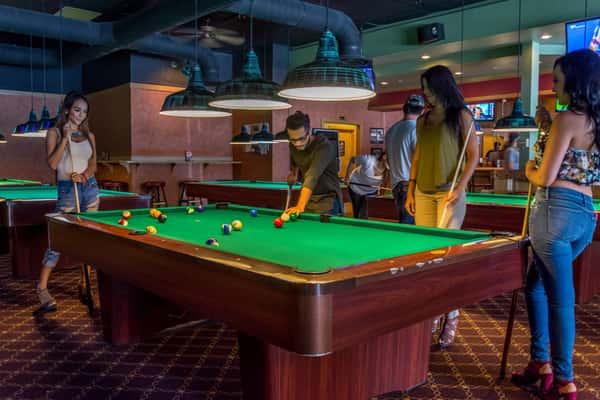 patrons shooting pool