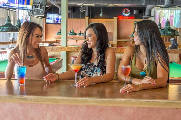 women talking over drinks