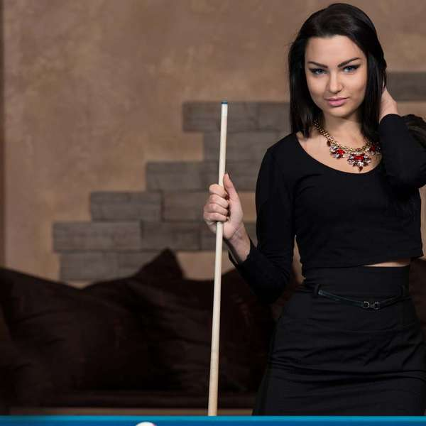 Woman with pool stick