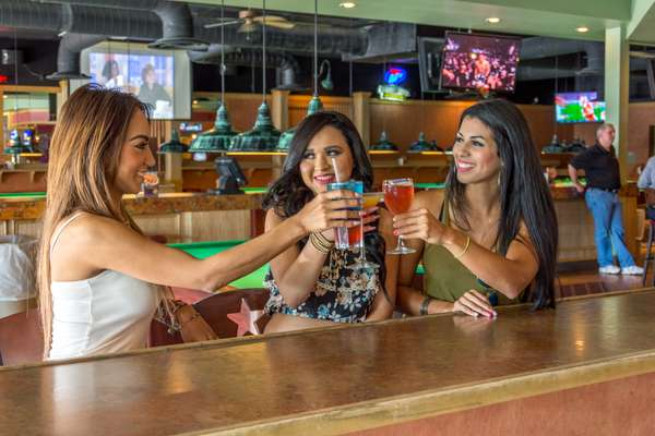 friends toasting bar