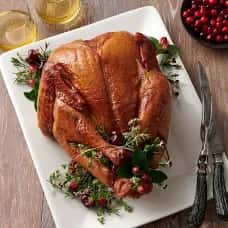 Smoked Turkey Dressed with fresh herbs and cranberries