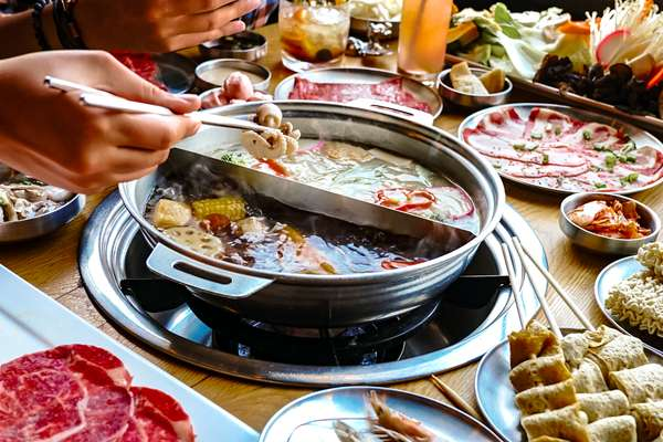 boiling meat over a hotpot