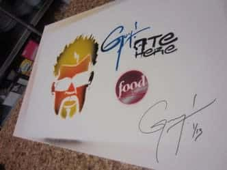 signed paper by diners, drive-ins & dives star