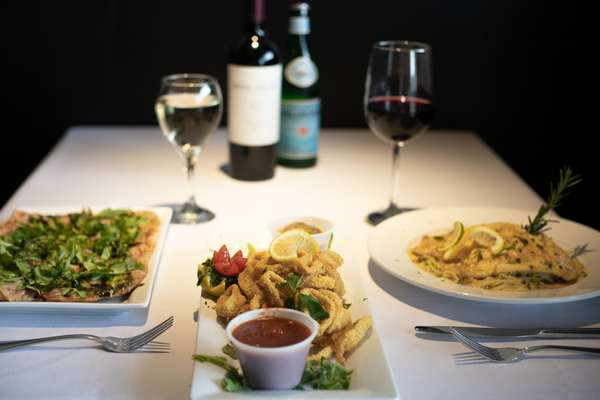 Two meals and appetizer paired with wine