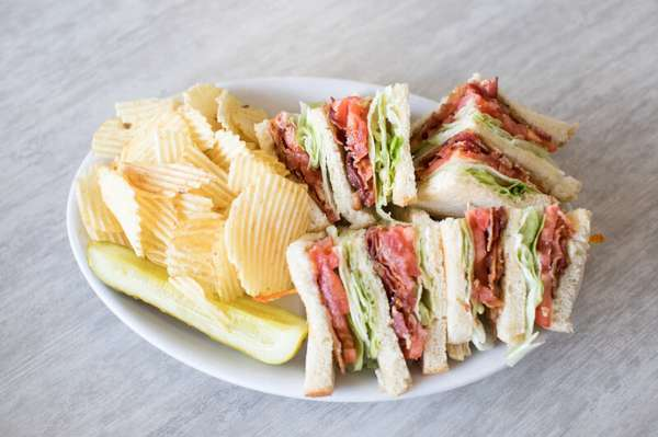 Turkey club sandwich with chips