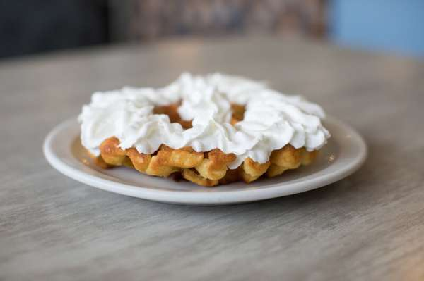 Waffle topped with whipped cream