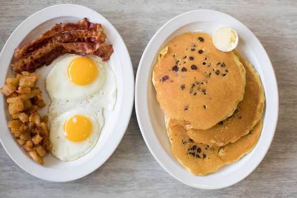 #5 Two Eggs, Home Fries, Bacon, Ham or Sausage, Three Pancakes & Juice