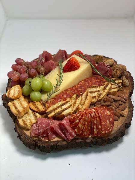 Serverd on a wood tray Charcuterie