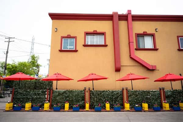 A photo of the exterior of El Asador Summer Patio