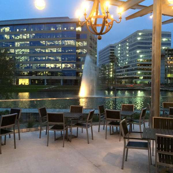 Exterior dining with lakefront view