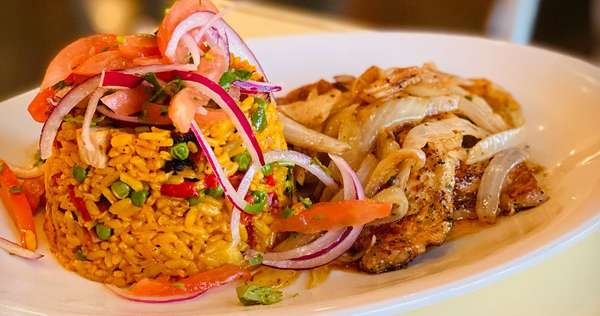 artistic Cuban entree with rice and meat
