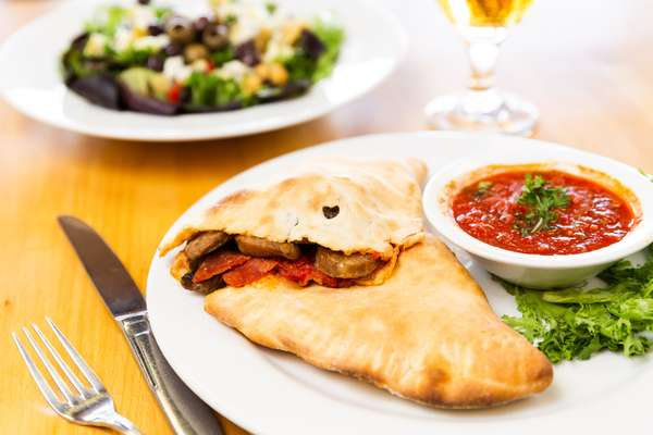 Calzone with salad and beverage