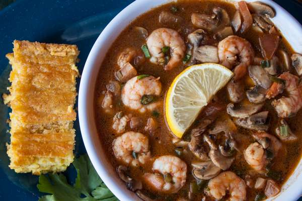Creole Shrimp Over Cheddar Grits, Egg and Bread