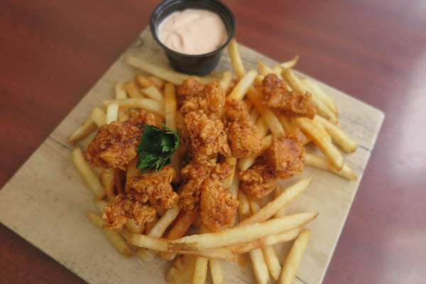 Chicken Strips Over French Fries