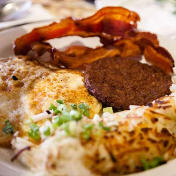 breakfast with eggs, sausage, bacon and hashbrowns