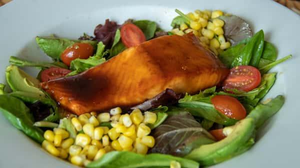 Wild-Caught Salmon Filet On Greens