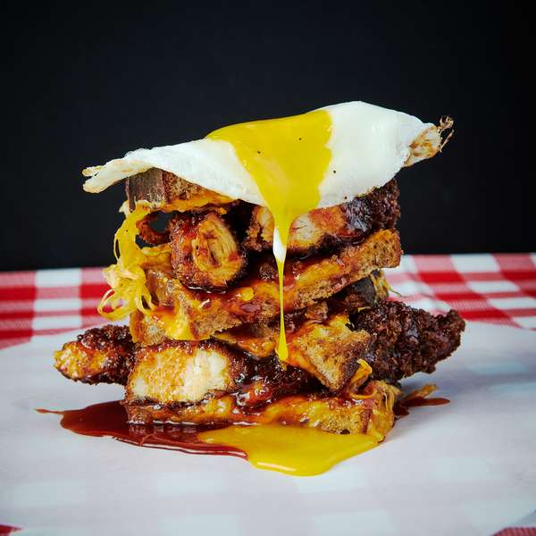 Fried chicken grill cheese sandwich with a sunny side up egg
