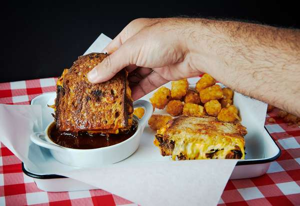 Birria grill cheese sandwich and side of tater tots
