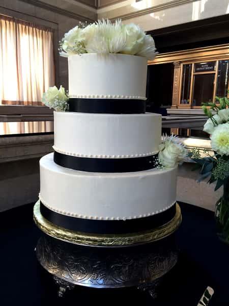 cake with black ribbon