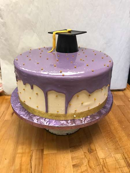 graduation cake with purple icing
