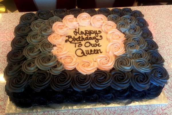 cake with pink and black roses