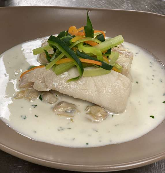 Blanched haddock and clam sauce