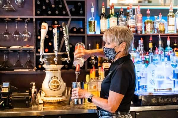 bartender pouring liquor