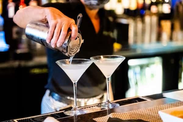 bartender straining drinks