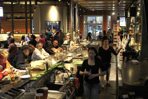 People dining at the bar at Santa Fe Capitol Grill